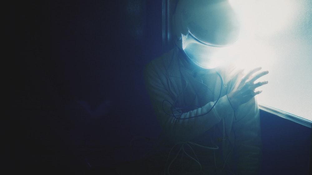 man in white crew neck shirt wearing black goggles