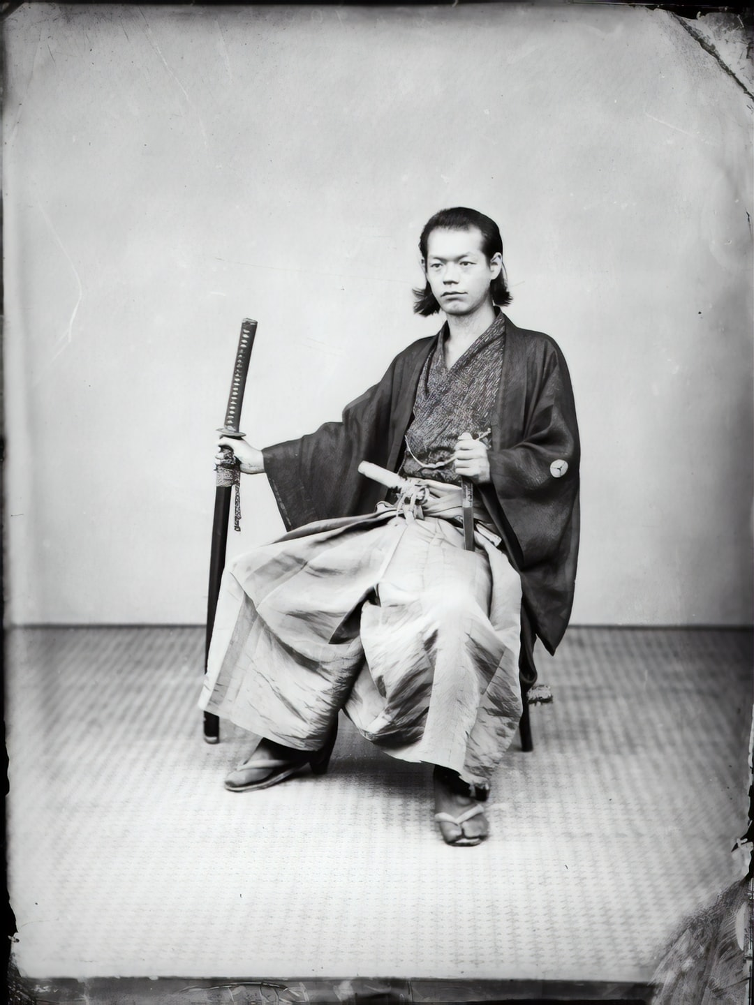 Portrait of a Jakonin. On the Austro-Hungarian expedition 1868-1870: Seated Jakonin (official) with two swords. Studio shot.