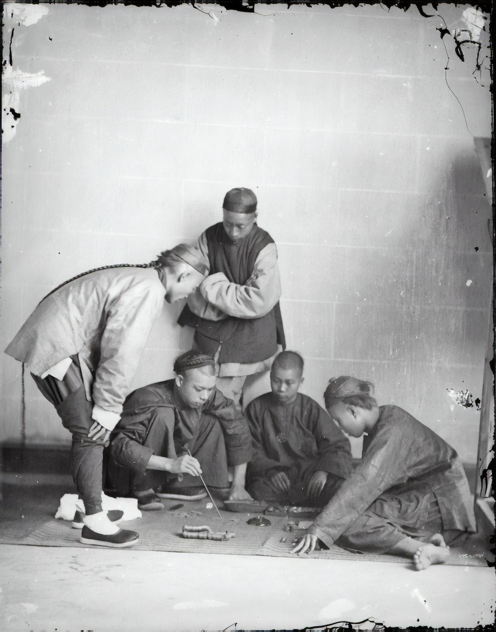 3 men sitting on floor