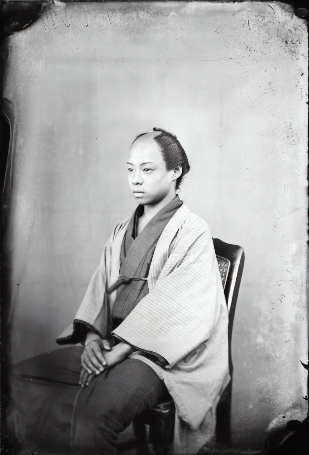 woman in white robe sitting on chair