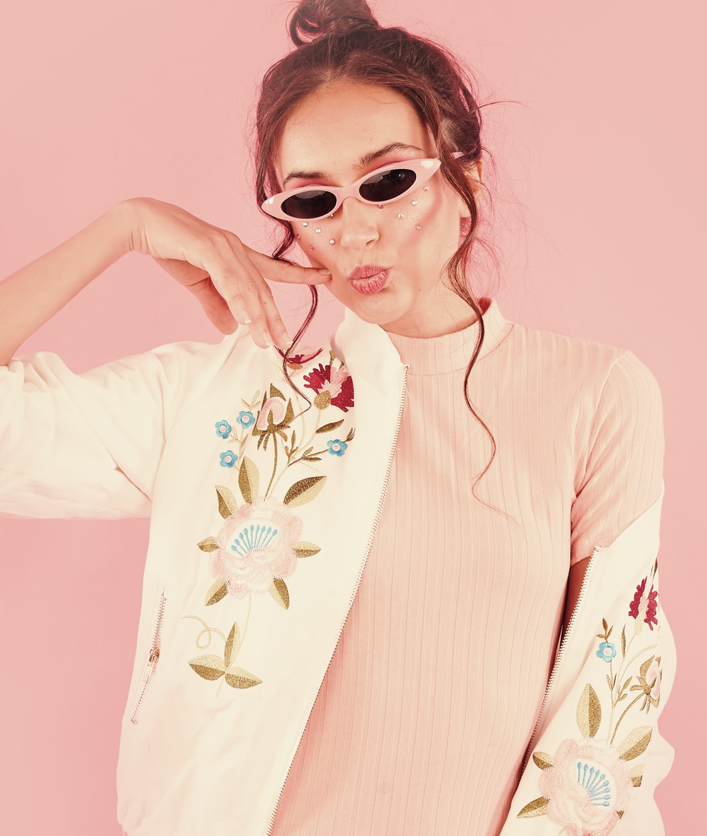 woman in white and red floral long sleeve shirt wearing sunglasses