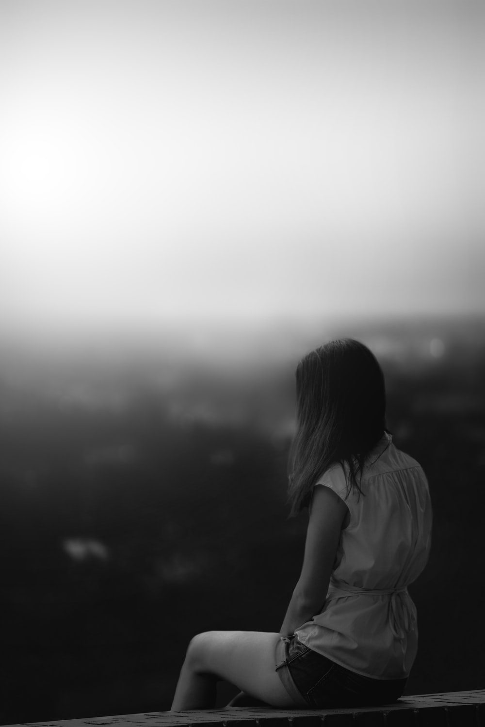 grayscale photo of woman in white shirt