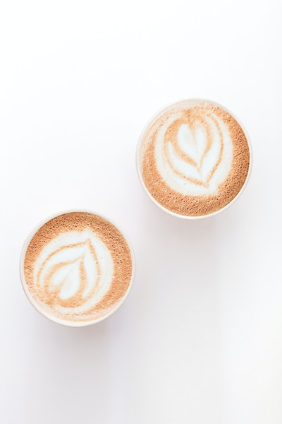 brown and white heart shaped cappuccino