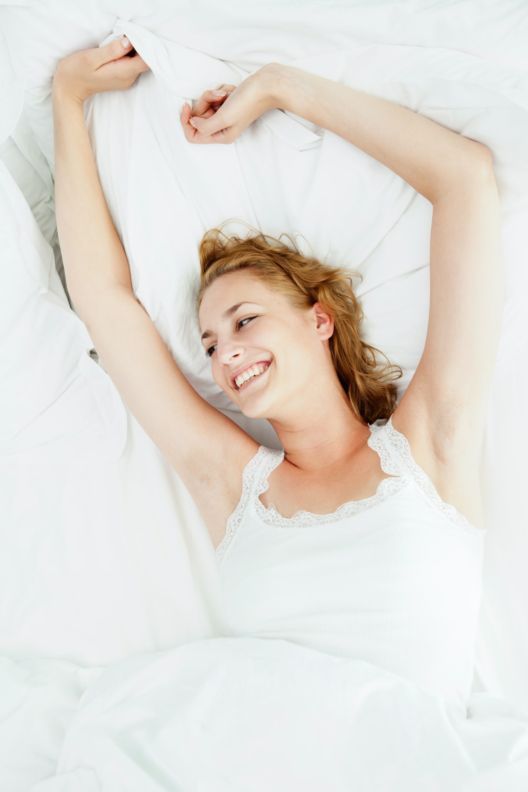 Waking With a Smile: How a Deeper Sleep Can Improve Your Skin