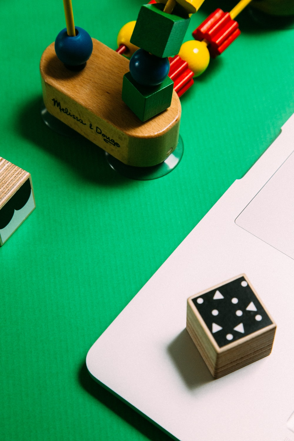 white and black dice on green wooden table