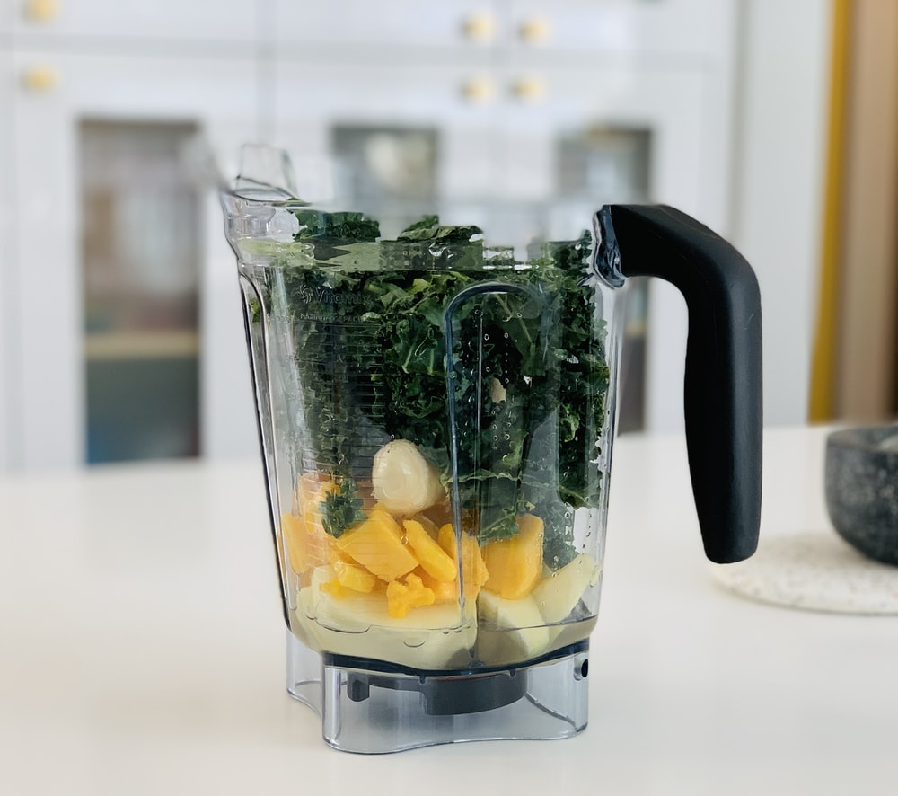 clear glass pitcher with sliced fruits