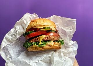 burger on white paper bag