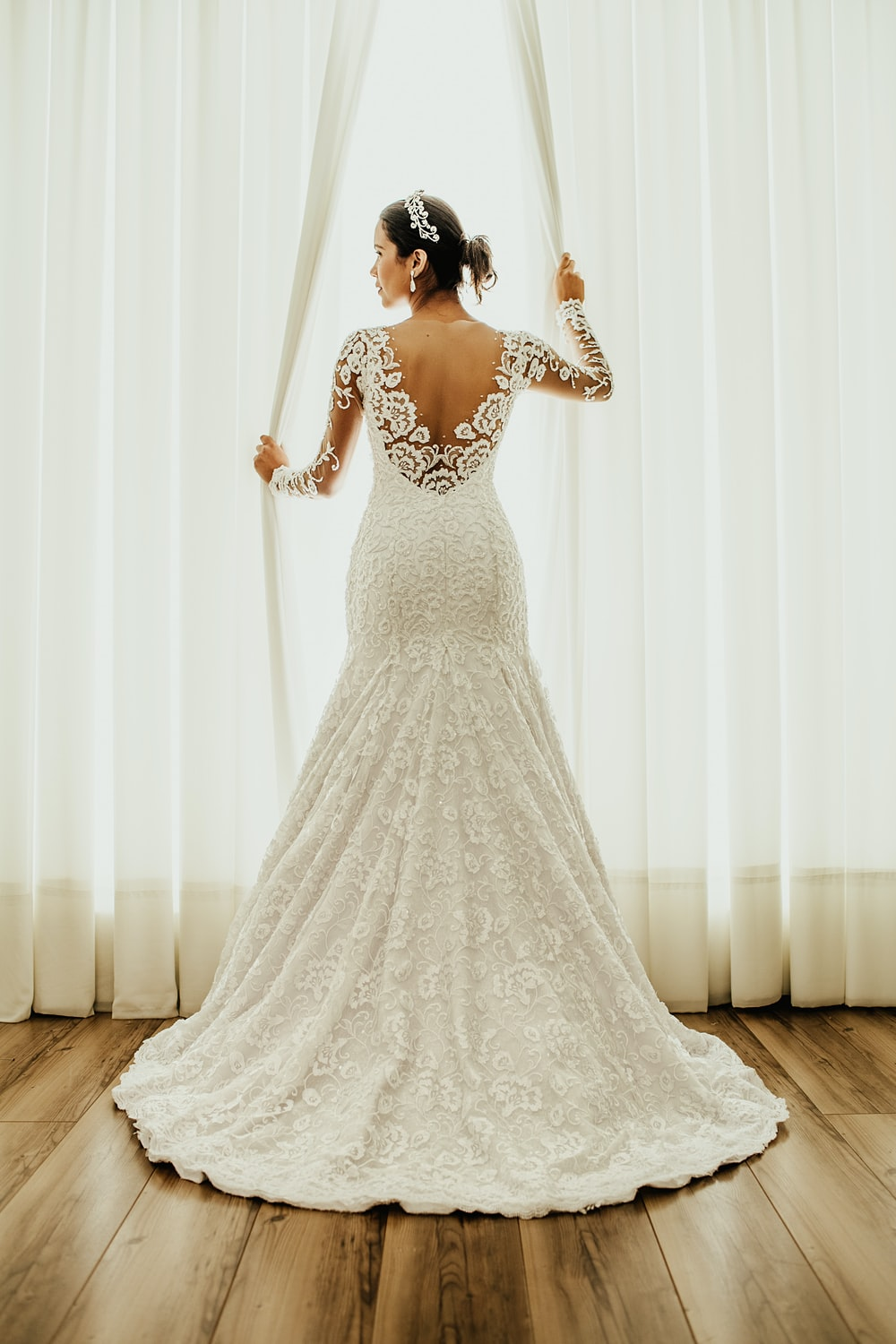 white wedding dress and white curtains