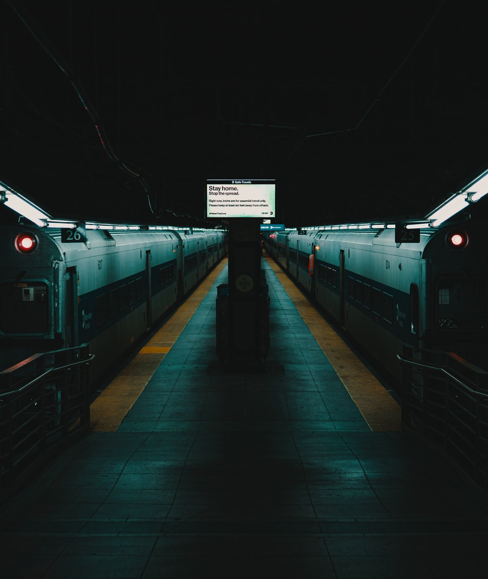 train station with white and green lights