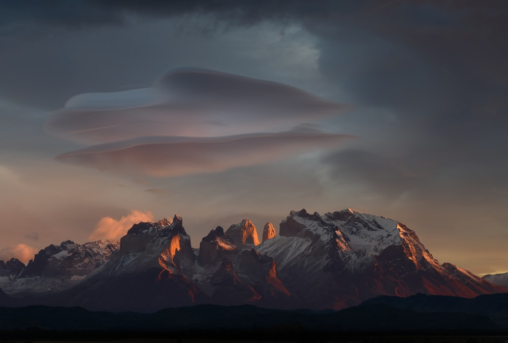 rocky mountain under gray clouds