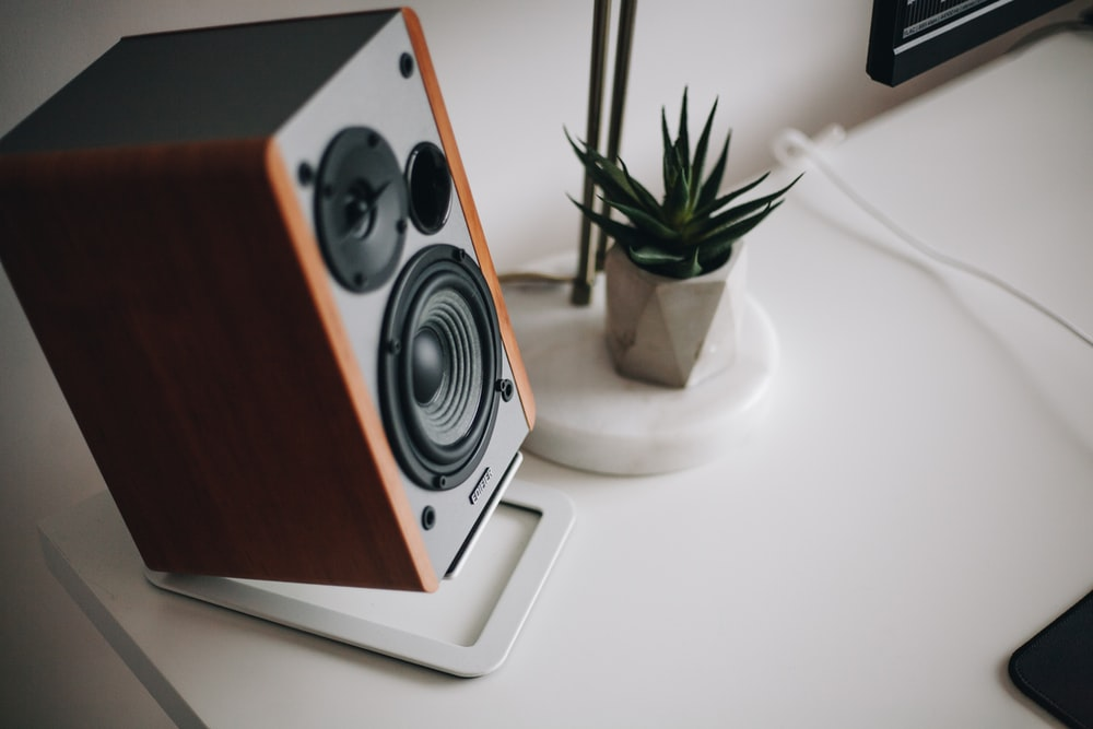 black and brown speaker on white table