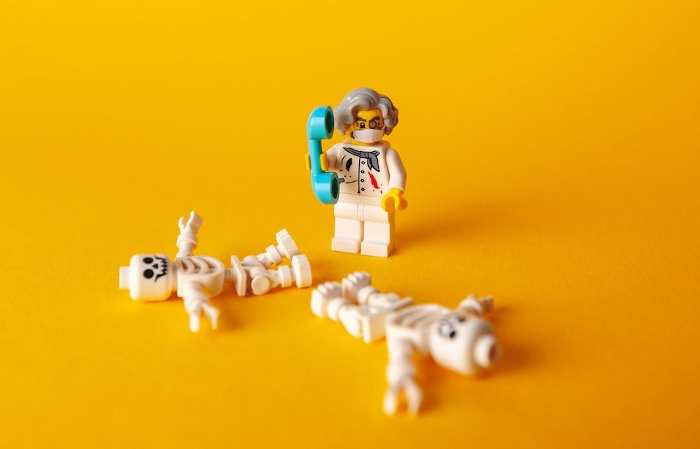 lego mini figure on yellow textile