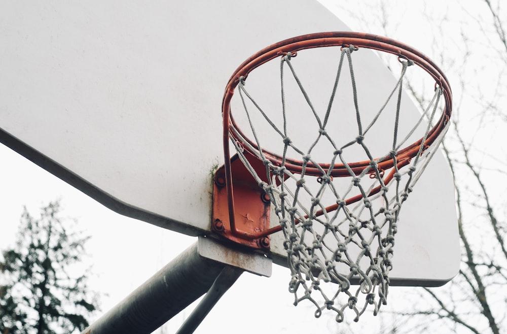 orange basketball hoop on white wall