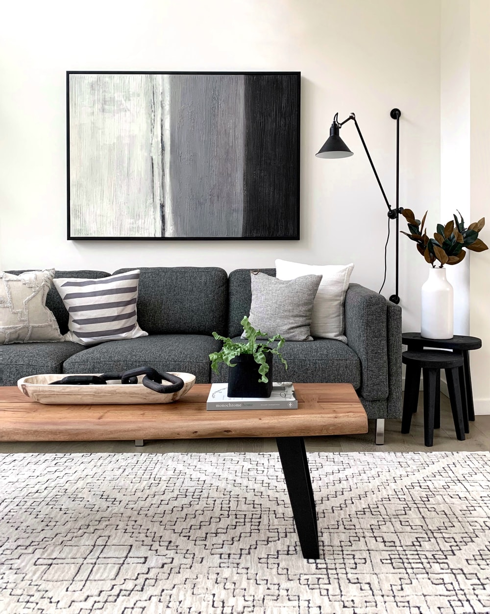 black and white throw pillows on gray couch
