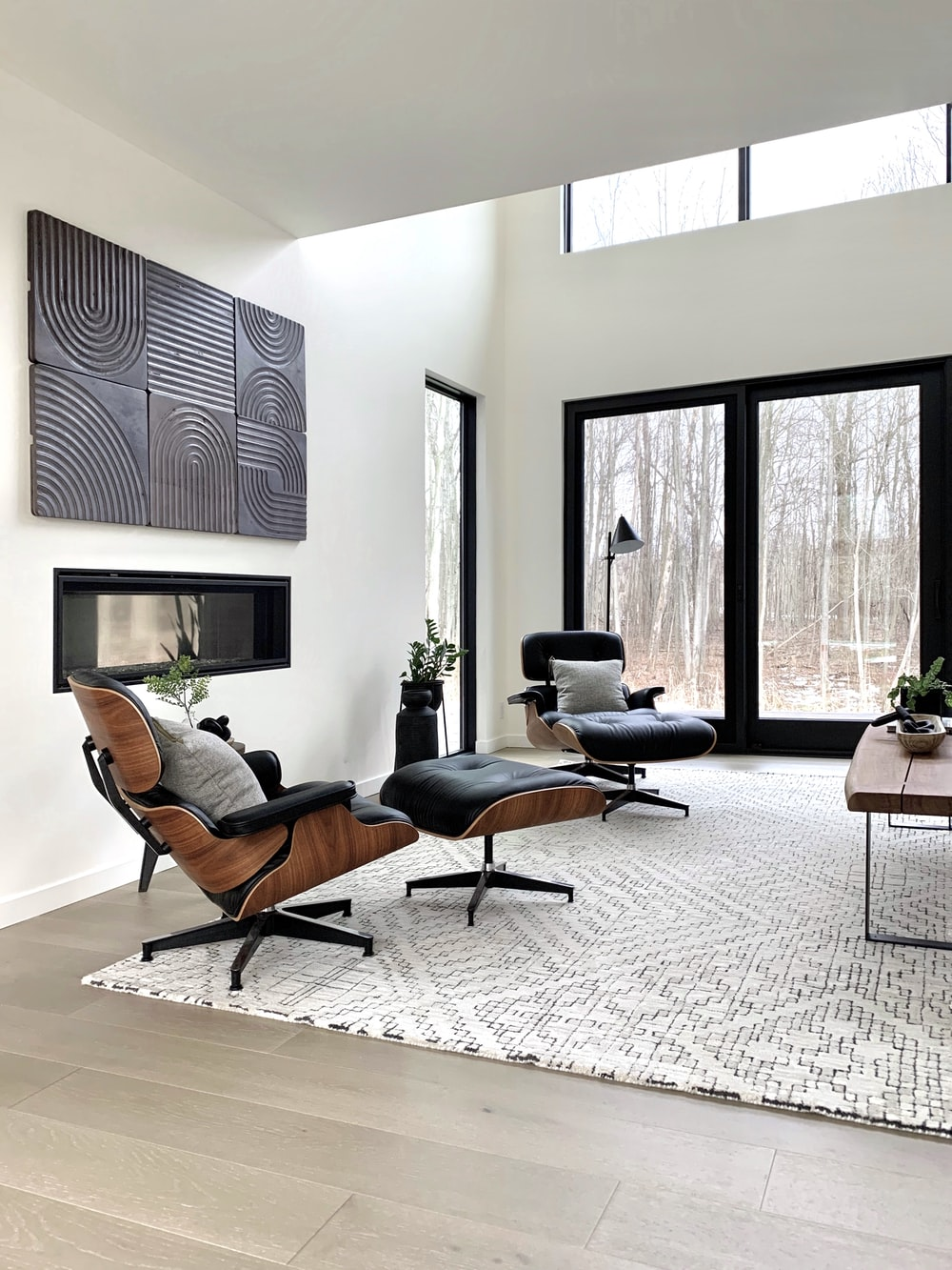 black leather padded armchair near black wooden framed glass window