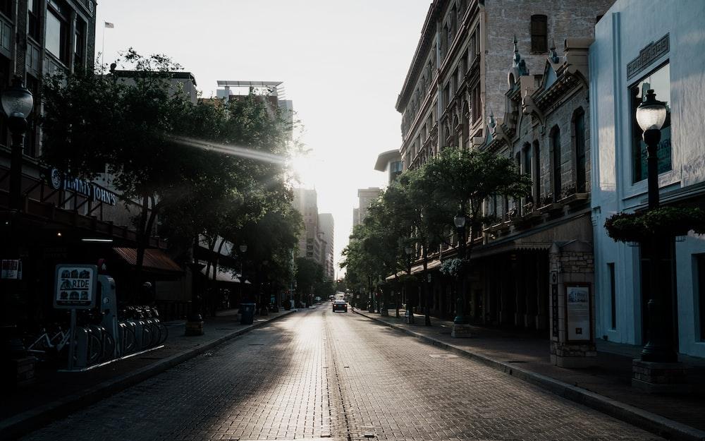 people walking on sidewalk between buildings during daytime