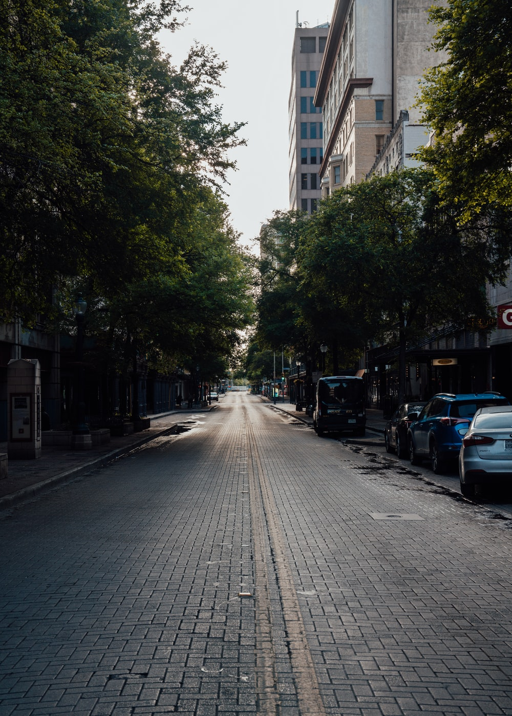 cars parked on side of the road during daytime