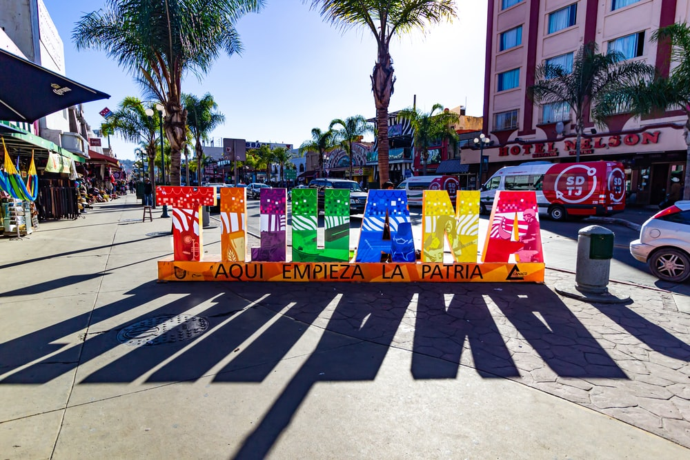 assorted colored plastic bags on street during daytime