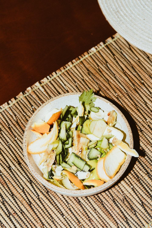 sliced vegetables on white ceramic bowl
