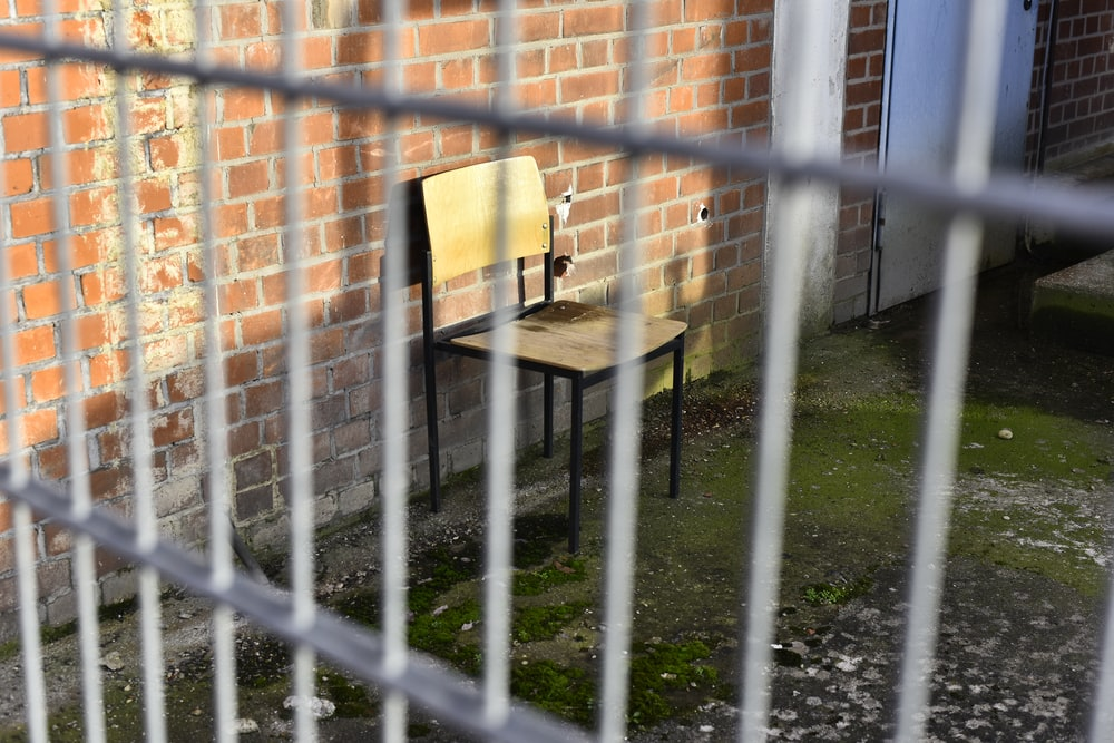 black metal fence near brown wooden table