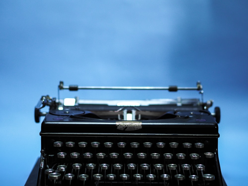 black typewriter in close up photography