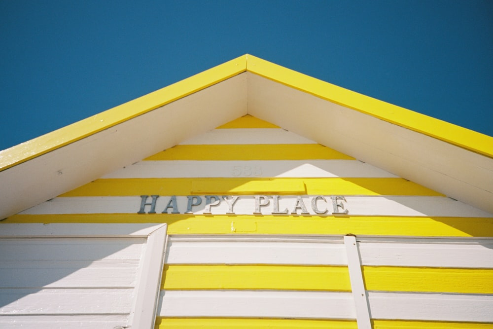 yellow and white wooden house under blue sky during daytime