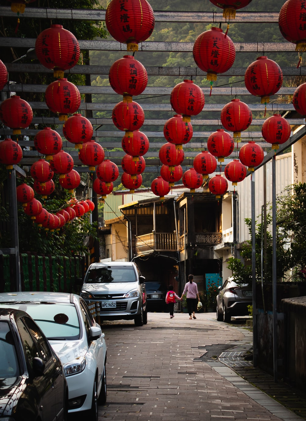 red round balloons on street during daytime