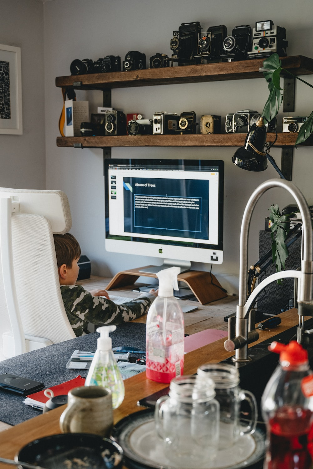 white flat screen computer monitor on brown wooden table