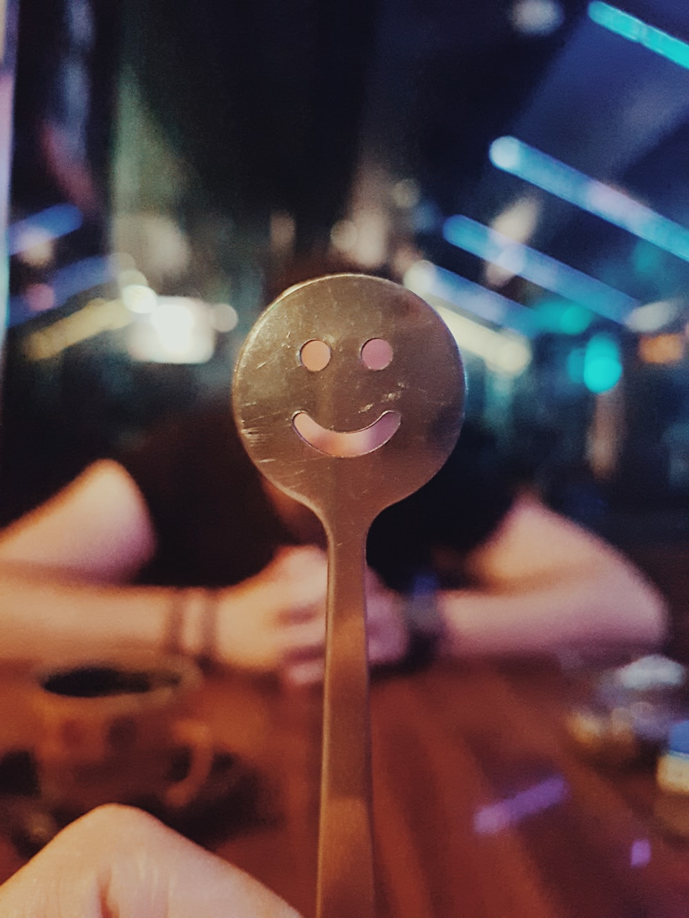 person holding silver spoon with light