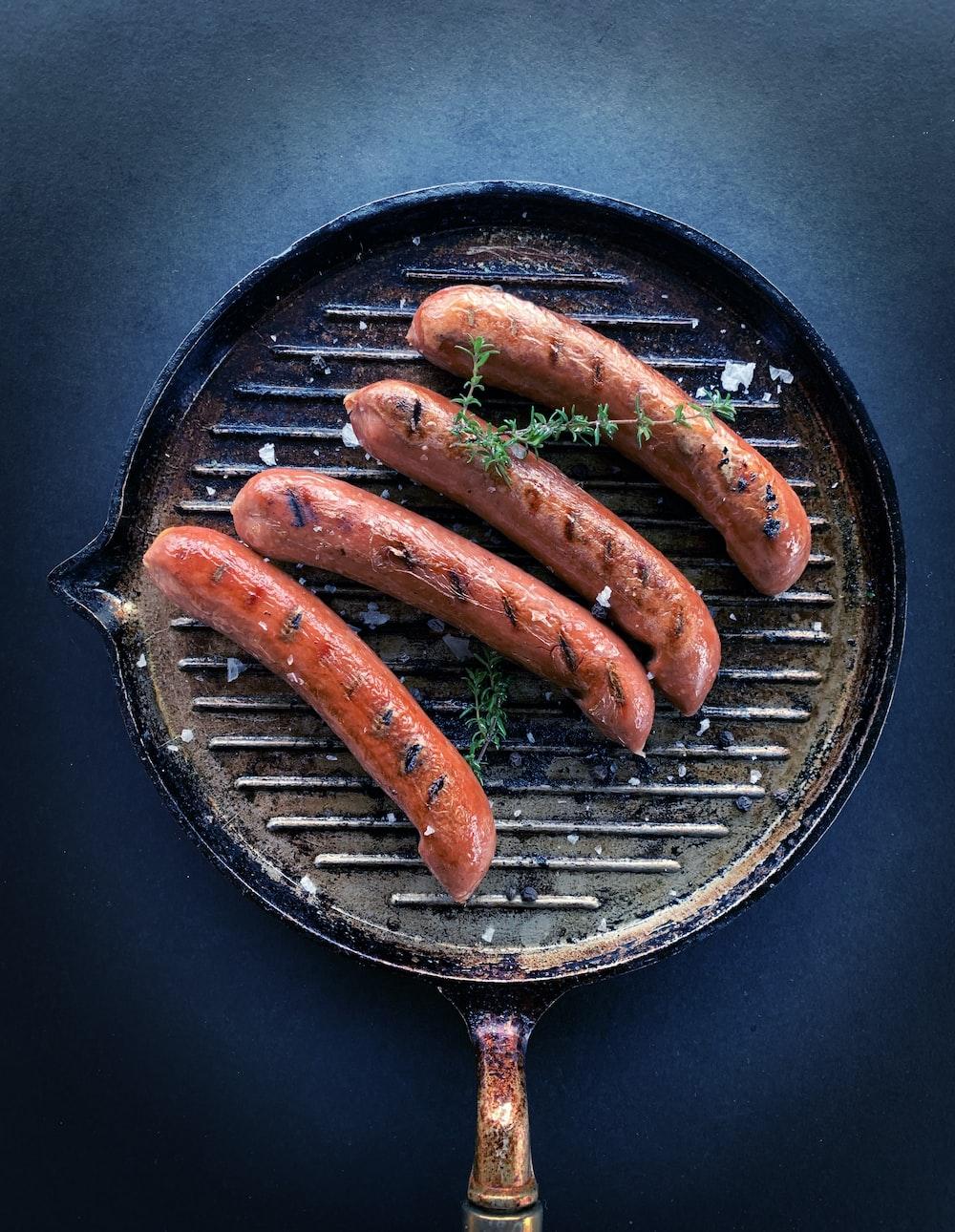 sausage on black round pan