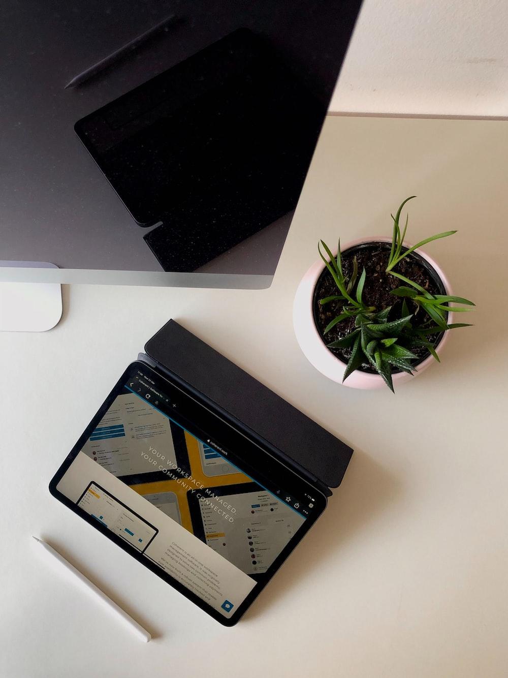 black ipad on white table