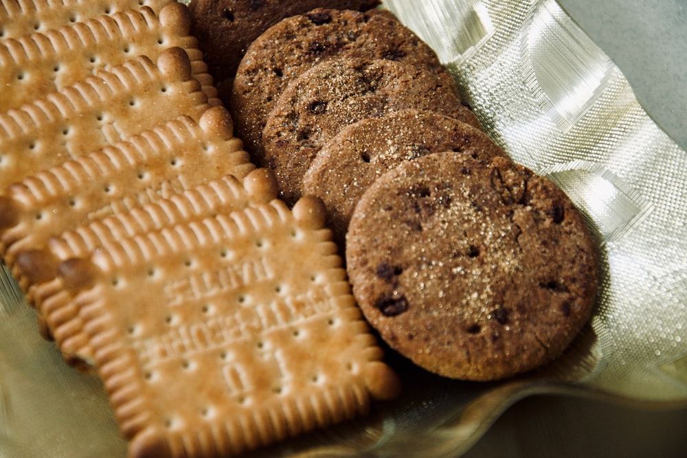 brown cookies on clear plastic container
