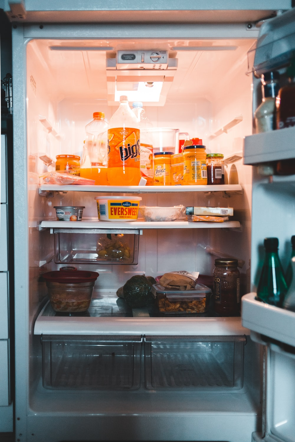 white refrigerator with assorted items