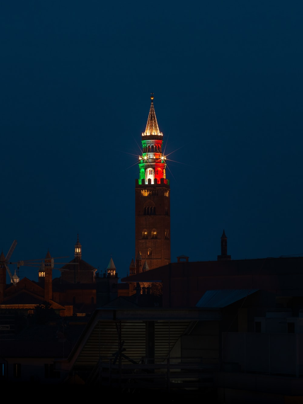 brown and red tower during night time