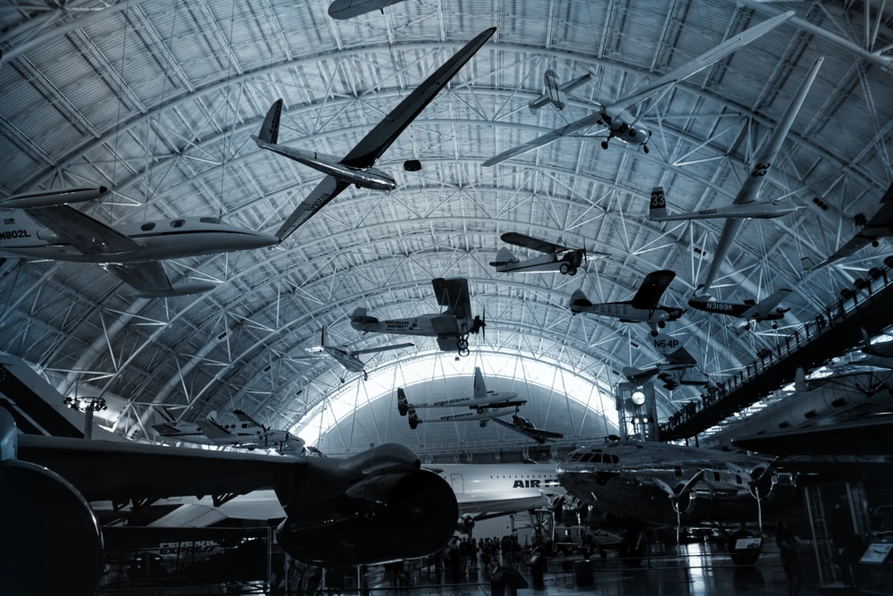 black and white airplane in a building