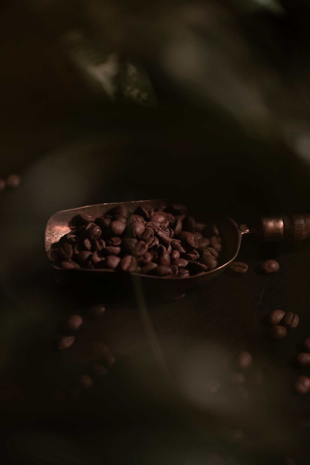 brown coffee beans on brown wooden table