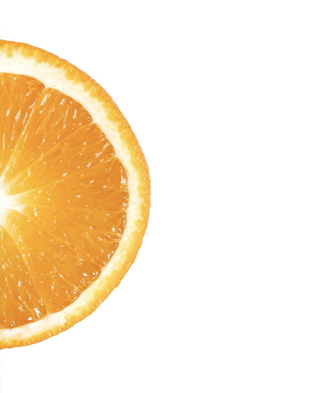 sliced orange fruit with white background