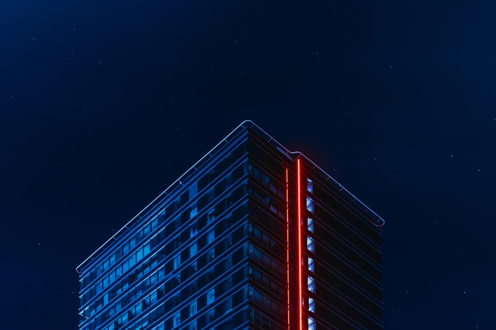 blue and red glass building during night time
