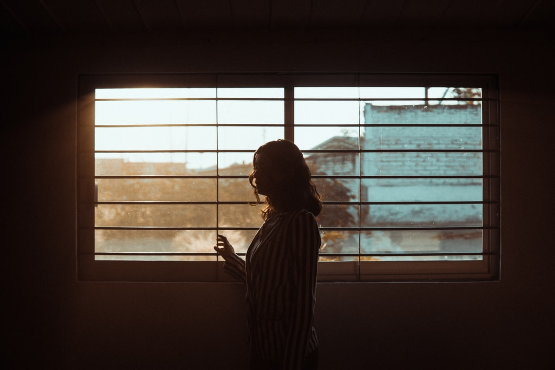 A woman looking through the window.