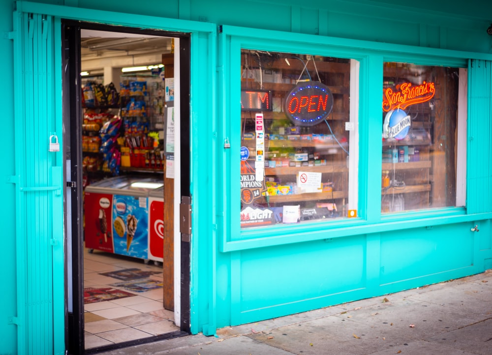 blue and brown store with blue wooden door