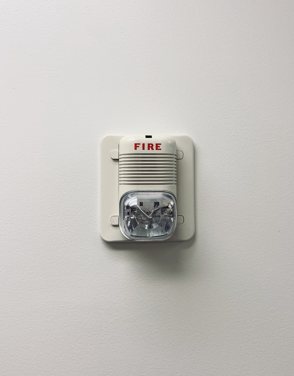 white and black electric device mounted on white wall