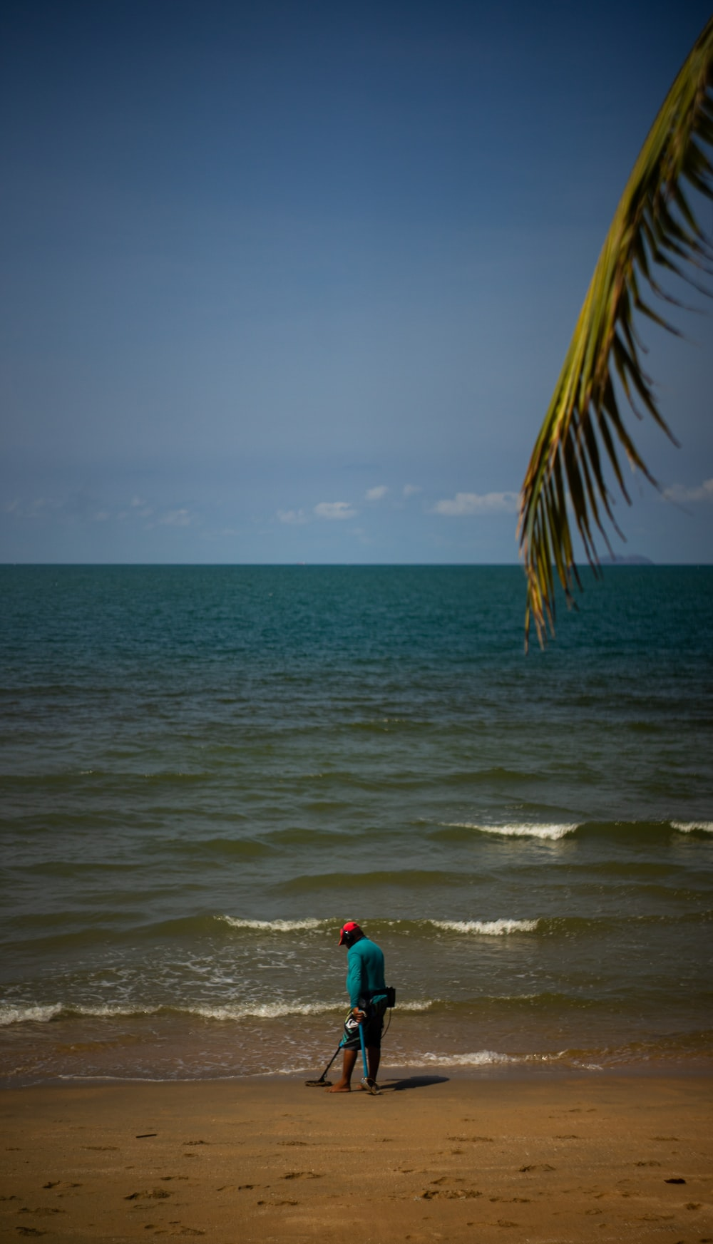 person in blue shirt on beach during daytime