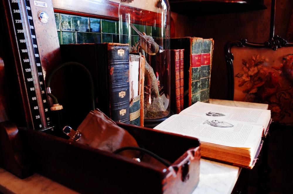 brown leather handbag on white table cloth