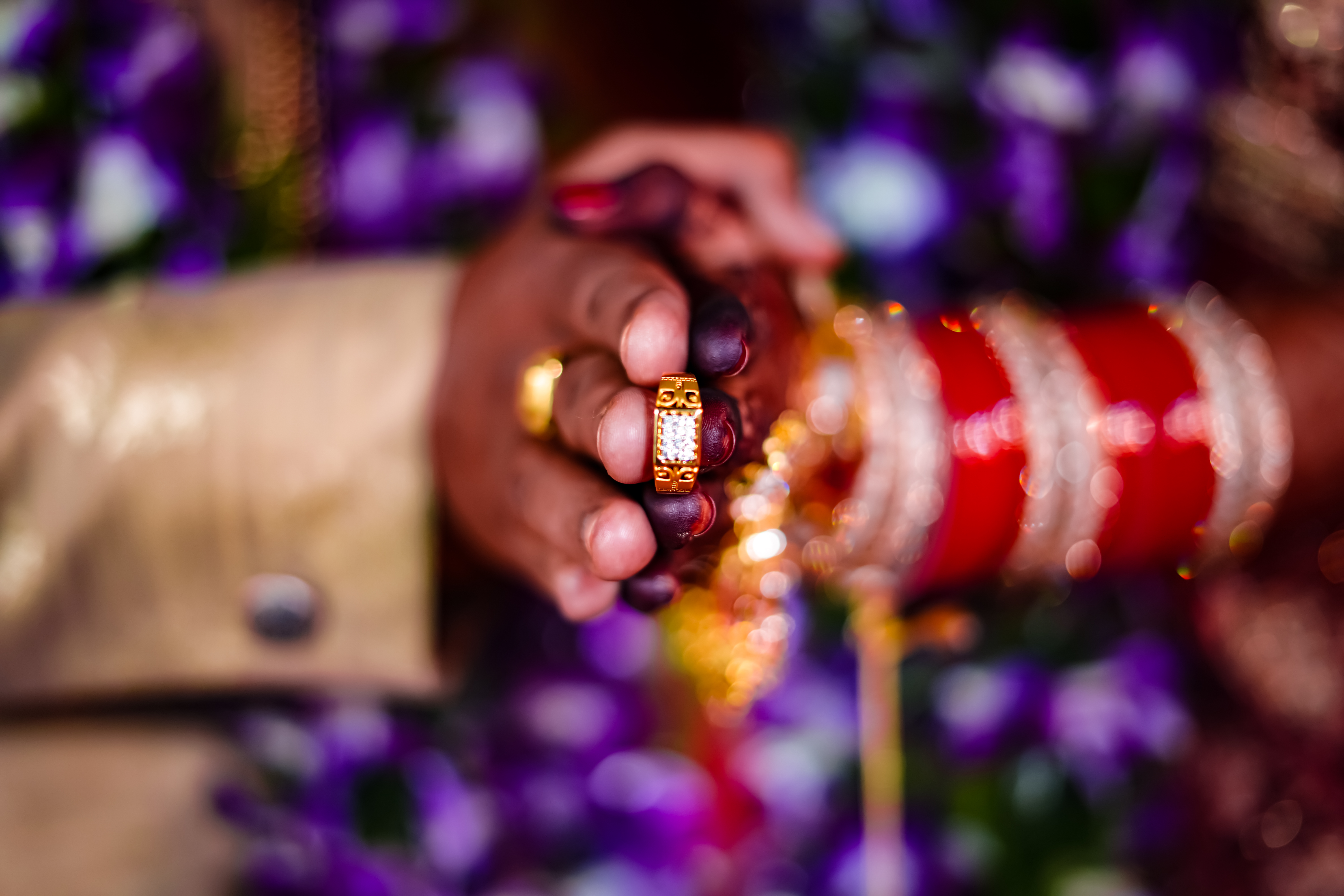 Get the wedding ring in your hand and get it photographed.