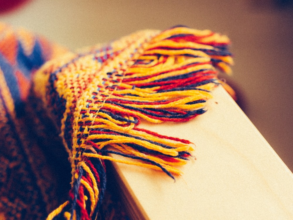 blue orange and yellow knit textile
