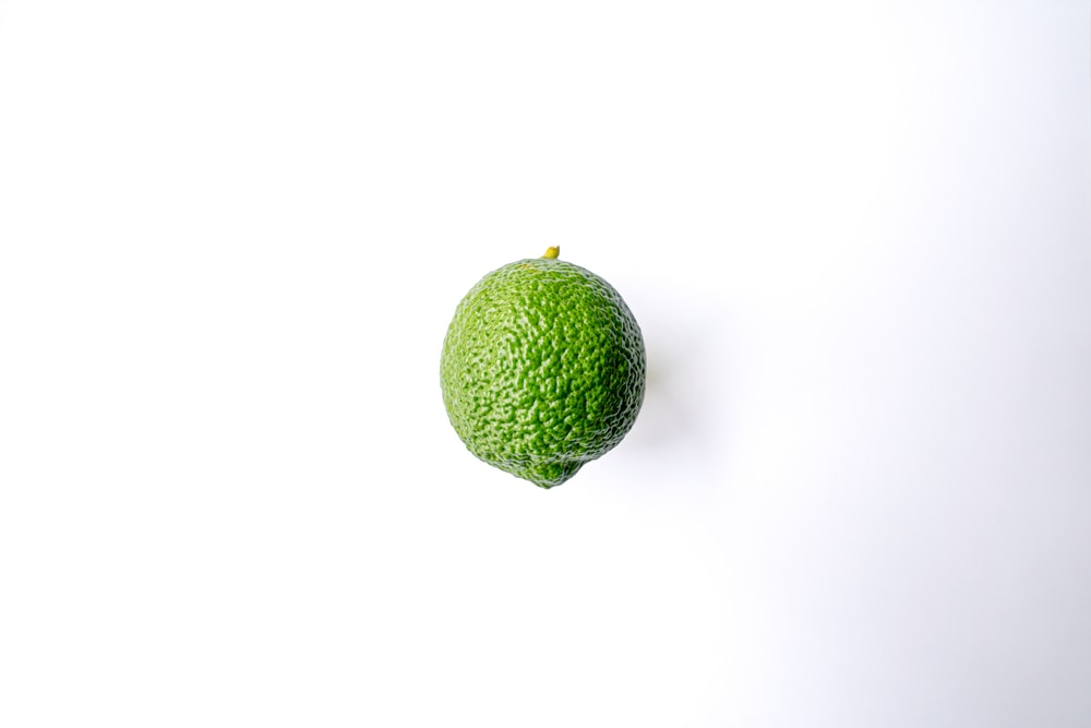 green fruit with white background