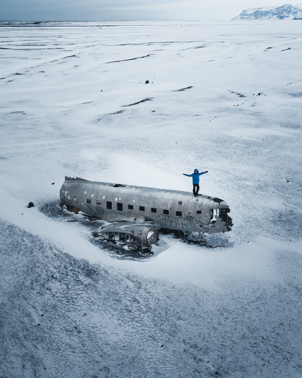 black and white ship on snow covered ground during daytime