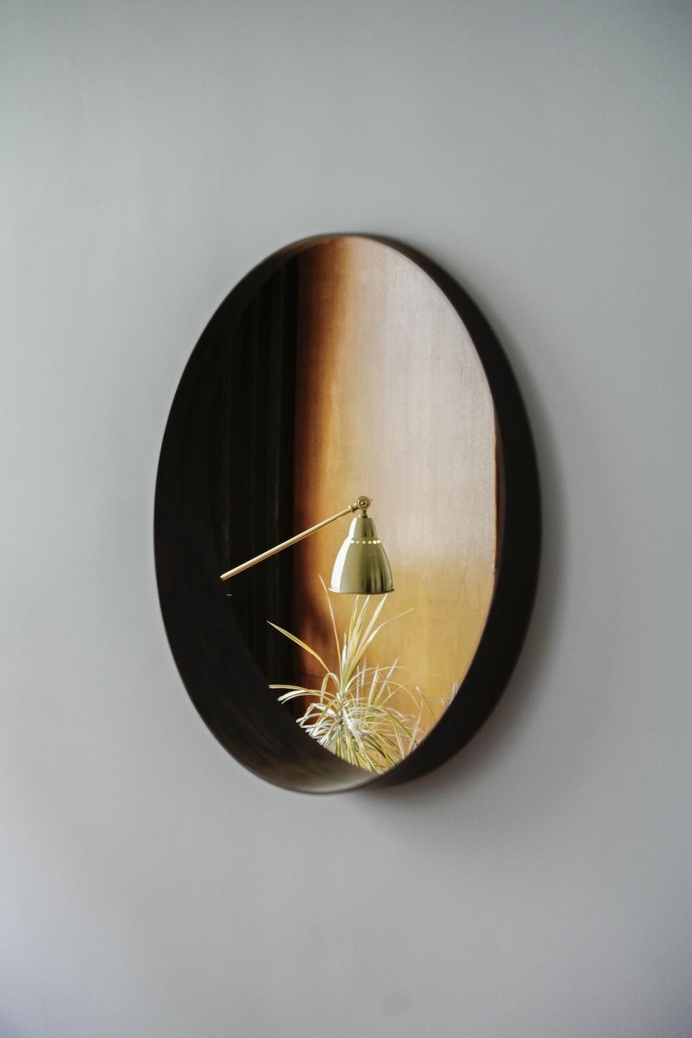 brown wooden round wall clock