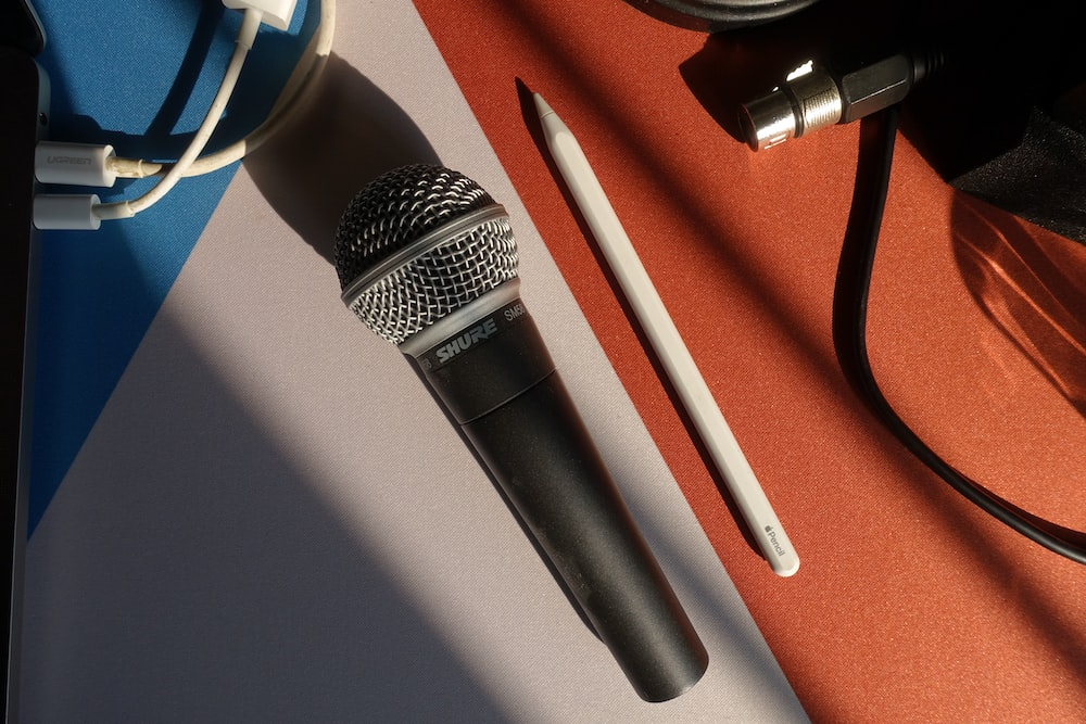 black and silver microphone on white table