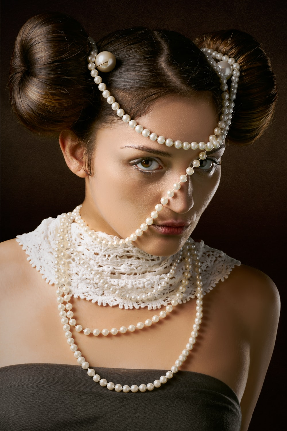 woman in white pearl necklace
